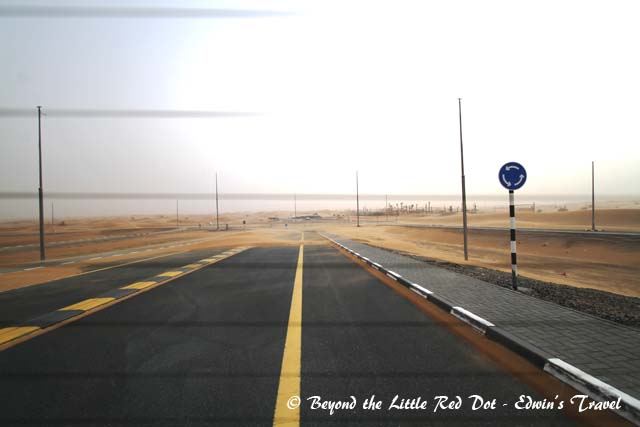 As we drove out of Dubai into the desert, we could see the sand storm covering up the road with sand.