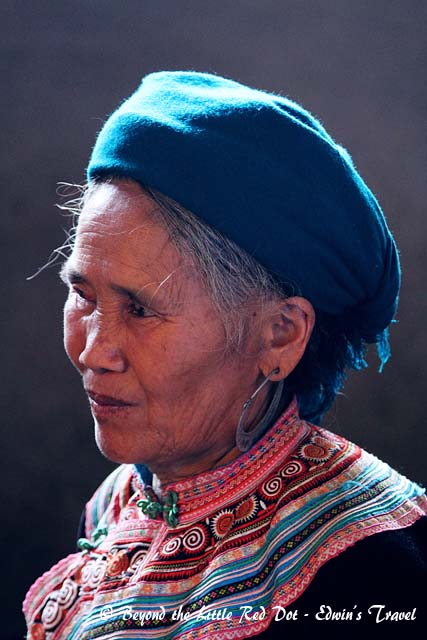 Another H'mong matriarch. She was making moonshine from corn.