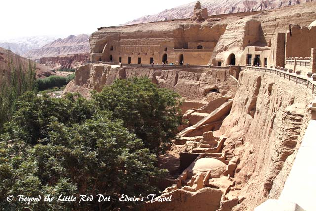 The Bezeklik Thousand Buddha Caves. There is a river running beside it and forms an oasis in the desert.