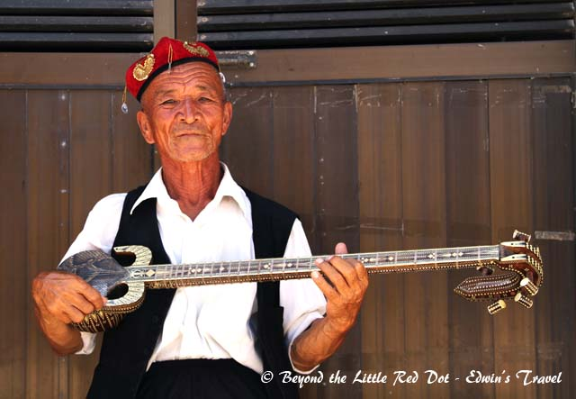 An enterprising old man who entertains you for some donations. You can play his musical instruments and take photos with him.
