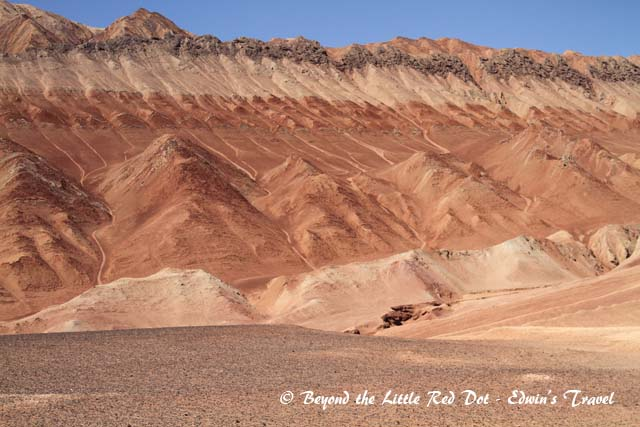 The mountains are colorful with many distinct layers of rock, sandstone, and sand.
