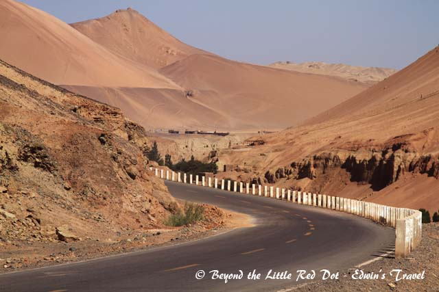 The desert highway that goes round to the back of the Flaming Mountains.