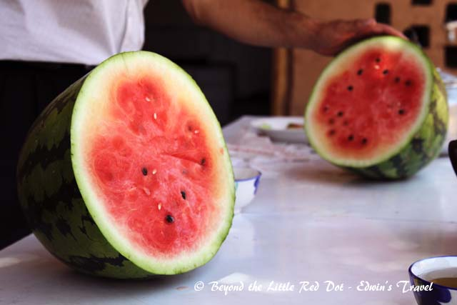 Our guide had bought melons from the local vendors. They were very sweet and juicy. Perfect in the hot weather.
