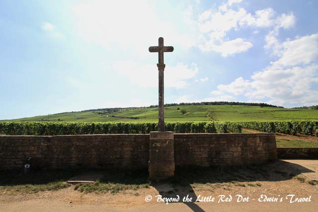 Behind the cross is the vineyard for the most expensive wine in Burgundy - Domaine de la Romanée-Conti at more than €3,000 per bottle and a 12 year waiting list.