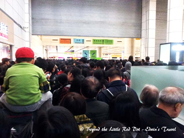 This is the start point after clearing Chinese immigration. There is no queue at this point, everyone is just being pushed forward and funneled into a single line. The Hong Kong immigration counters are right at the end of the room. It took 3 hrs just to cover the distance.