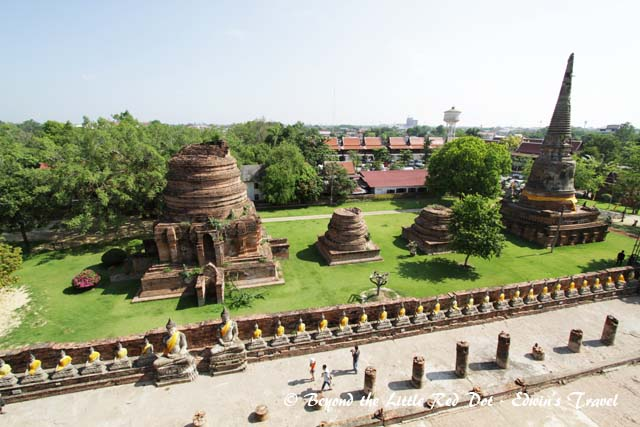 You can see the rows of restored Buddha statues that surround the temple.