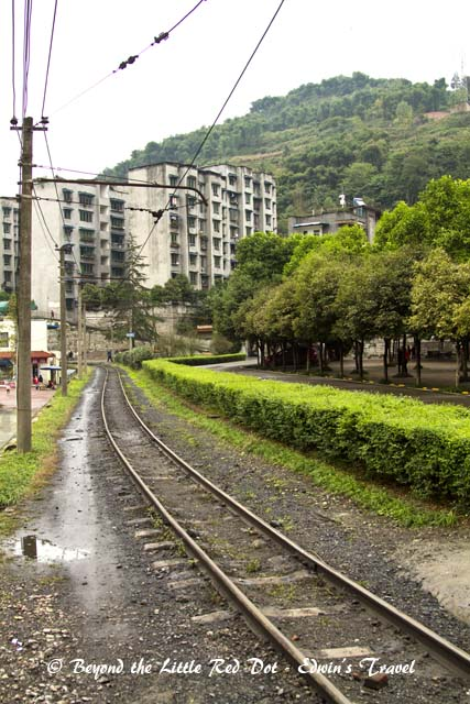 We crossed the railway tracks to get into the town. There are no signals. You just look left and right for the train and cross. The train travels quite slowly, so you have plenty of time to get out of the way.