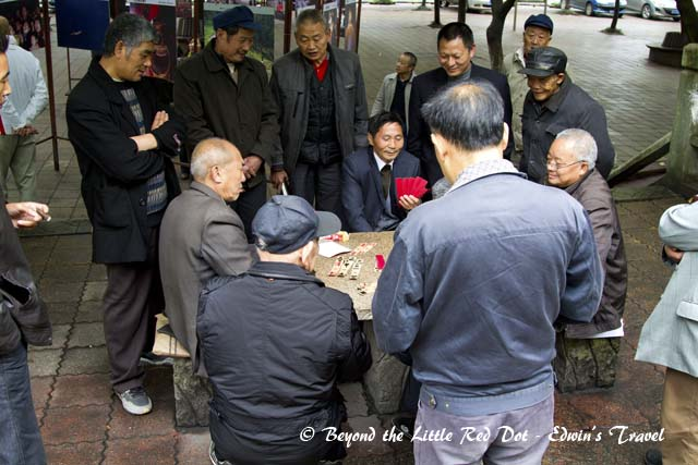 Around the train station there are groups of old men playing cards and passing the time on a Sunday.