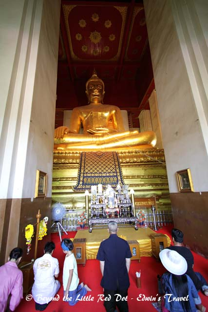 A large golden Buddha sits inside.