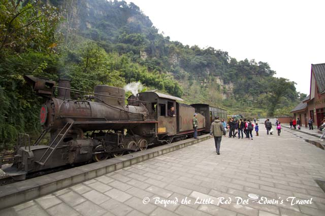 We stopped and got off at Bajiaogou village. The train continued on to Huangcun coal mine but we didn't buy the tickets for that visit. The train would come back later to pick us.