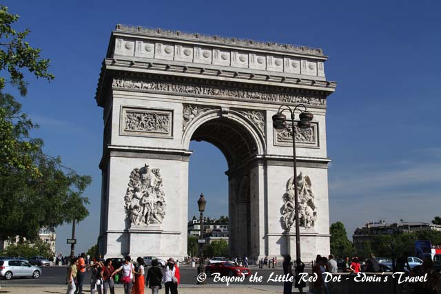 The Arc de Triomphe. It honours those who fought and died for France in the French Revolutionary and the Napoleonic Wars, with the names of all French victories and generals inscribed on its inner and outer surfaces. Beneath its vault lies the Tomb of the Unknown Soldier from World War I.