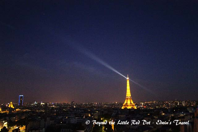 The Eiffel Tower light show. The light beam is only for a few seconds.