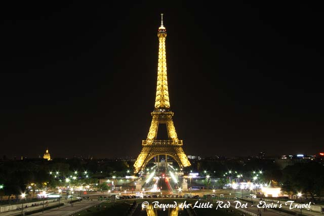 The Eiffel Tower lighted up.