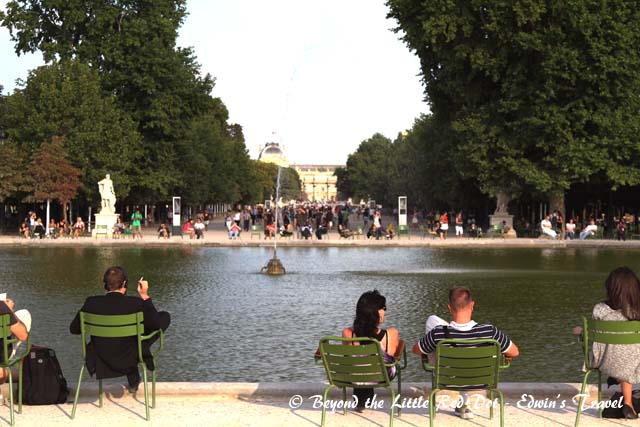 The Tuileries Gardens, with the Lourve Museum in the background.