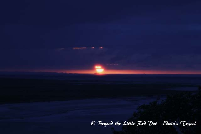 A very cloudy sunset over the Normandy coast.