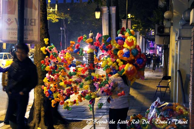 A balloon seller along the streets beside Hoan Kiem Lake.