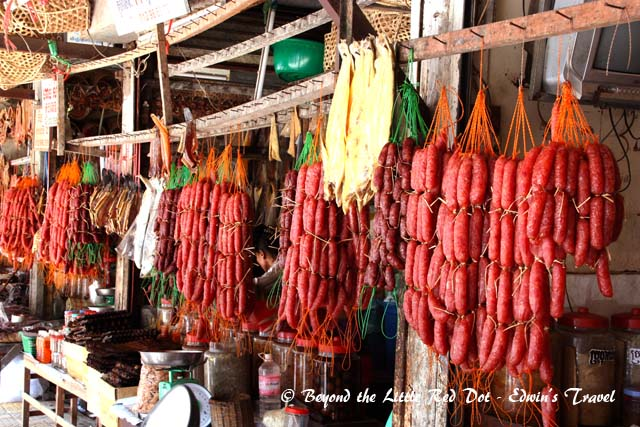 Dried sausages hanging from a shop in Psar Chaa.