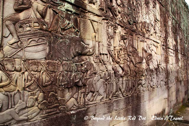 The walls of the temple are covered in stone carvings.