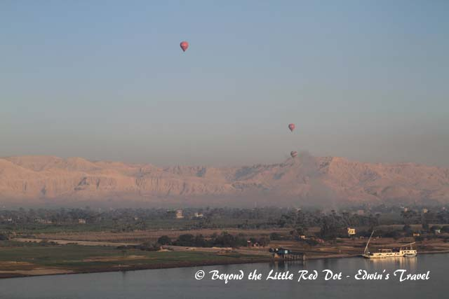 The morning of a new year. You can see hot air balloons flying over the Valley of the Kings.