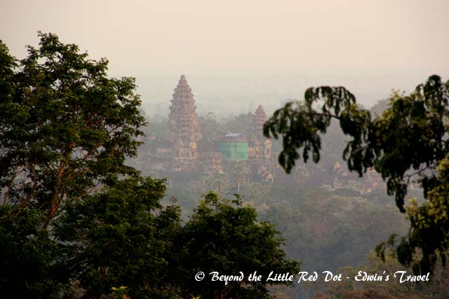 You can see Angkor Wat rising out of the trees from the top of the hill.
