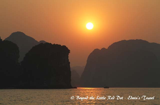 The sun setting over Ha Long Bay.