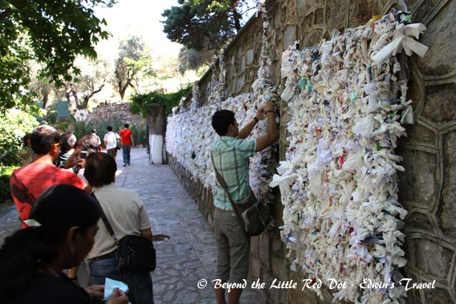 Pilgrims would write their wishes and tie it to the lattice on the wall.