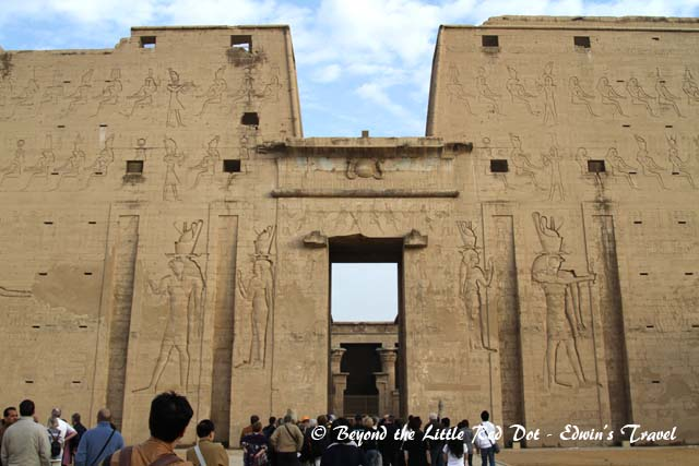 The Temple of Horus. It is one of the best preserved temples in Egypt. The large carving of Horus, the falcon headed god can be seen on the wall of the temple.
