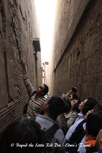 Our guide explaining the hieroglyphics on the wall.