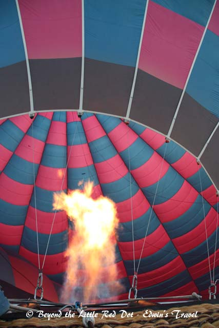 Blasting hot air into the balloon.