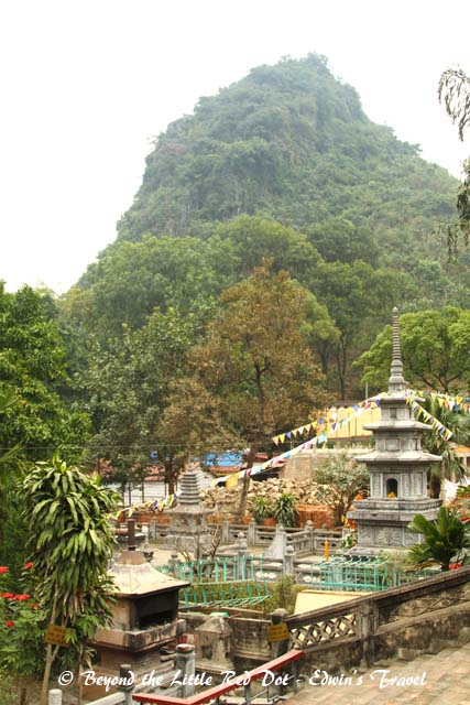 The temple is surrounded by mountains.