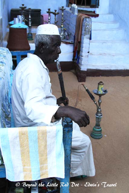 Grandpa having a smoke on the shisha pipe.