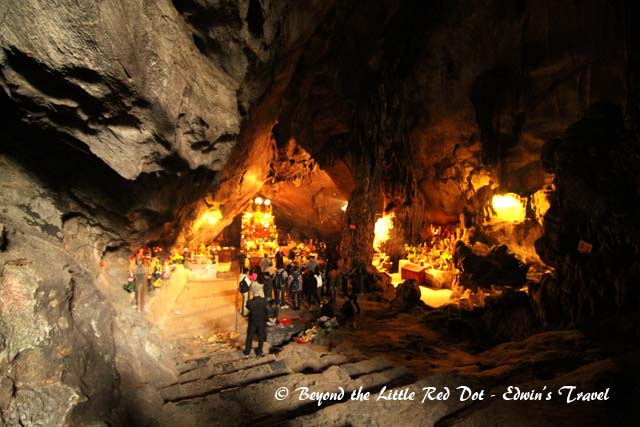 Behind the shrine is a cave which serves as the temple. There are several altars dedicated to different deities.