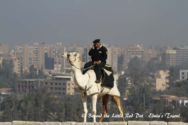 It's only right that the policeman should be riding a camel in Egypt instead of a horse.