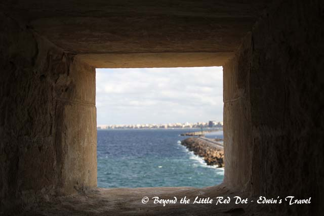 Looking through one of the windows in the fort, we can see the city of Alexandria.