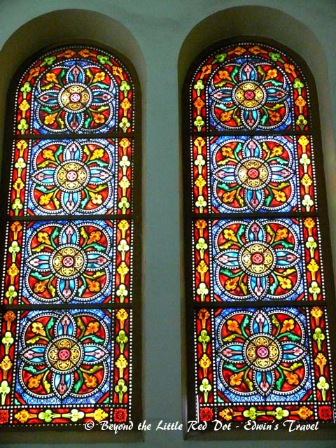 Beautiful stained glass windows adorn the church.