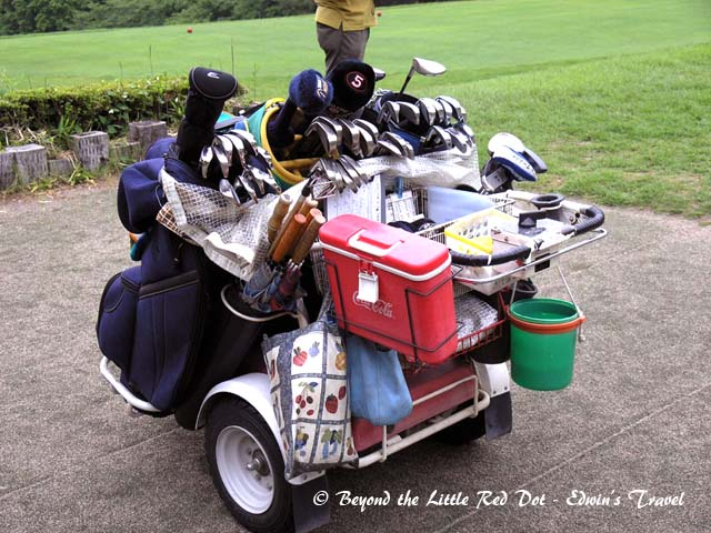 A lesson in productivity. We only had 1 caddy to service  4 of us. He uses this motorised cart to ferry our golf bags, carry drinks in the cooler box, selects and washes our clubs after play and he follows us throughout the 18 holes.