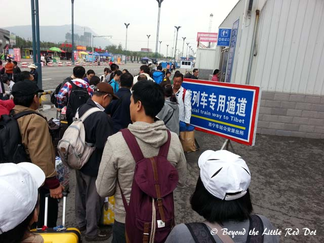 Queuing up to enter the train station. Security is very strict in letting only passengers with valid tickets through.