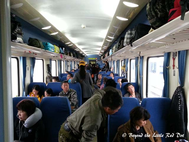 This is how cattle class looks like. This is the hard seater carriage and is the cheapest. It does mean that you have to sit for 24 hrs in an over crowded carriage with unwashed passengers sleeping on the floor, smoking, and eating next to eat other.