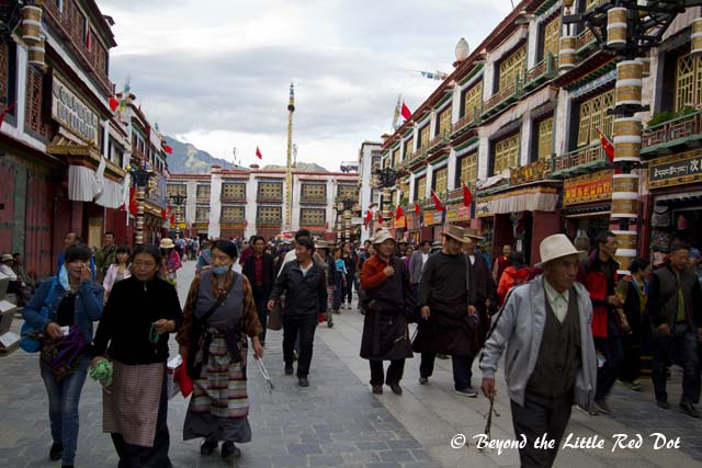 Tibetans walking along Barkhor Street as part of their devotions before praying at the temple itself.