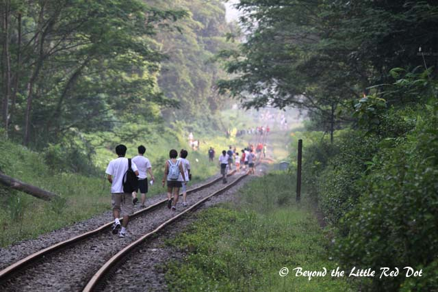As I approached the Bukit Timah Station, the small groups of people had congregated into a large crowd.