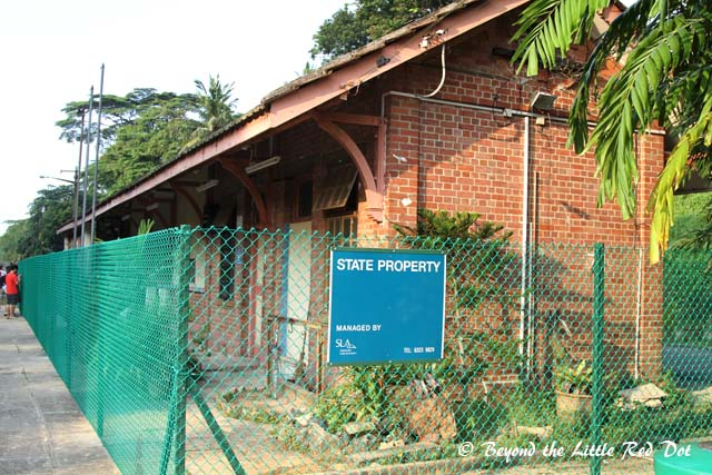 The Singapore government sure works fast. The station building was to be conserved and it was fenced up real quick.