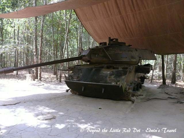An abandoned and partially destroyed American tank on display.
