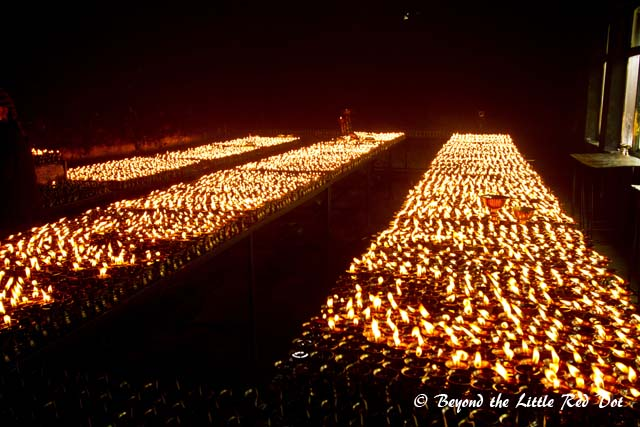 Thousands of oil lamps fill this small room and its like a furnace in there.