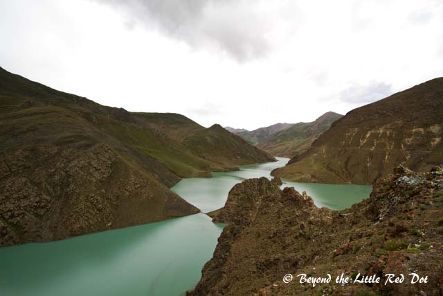 Yamdroktso Lake which appears green in colour.