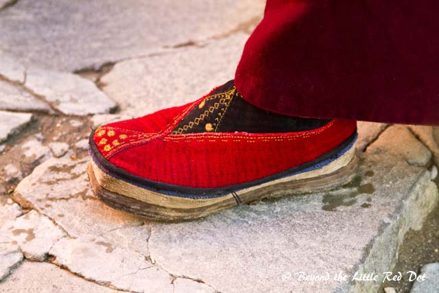 The monks here all wear traditional shoes.