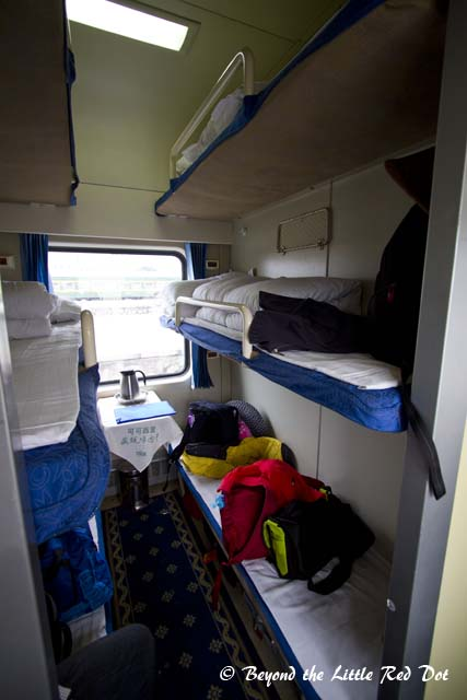 We got the hard sleeper cabins because we booked our tickets too late. It sleeps 6 persons to a cabin and there are no doors.