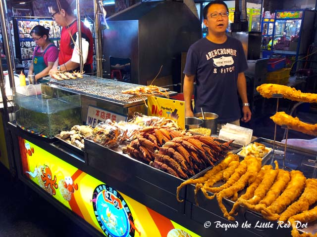 There are many stalls selling seafood. These are either fried or grilled. Look at the size of those tentacles.