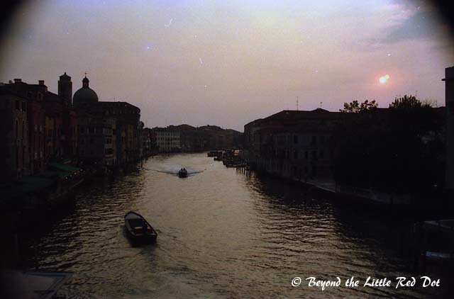 Sunset view of the canal separating Santa Lucia train  station from Venice. My hotel is somewhere on the right hand side.