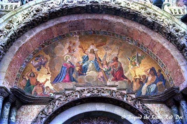 Elaborate paintings depicting crucial events in the bible adorn the entrance to the basilica.