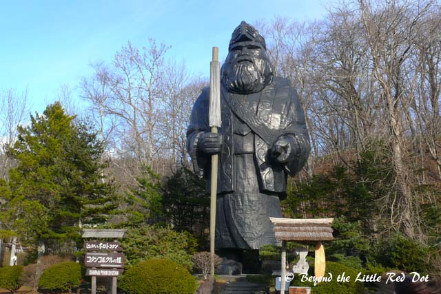 A statue of an Ainu warrior.